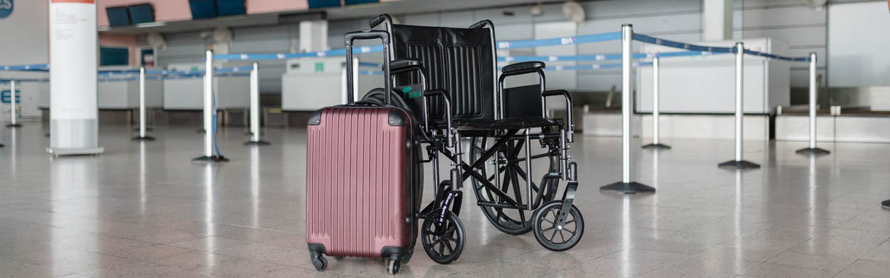 Case and empty wheel chair at airport